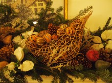 on the mantel, a sleigh filled with dried citrus