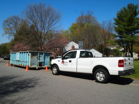 The dumpster & contractor truck