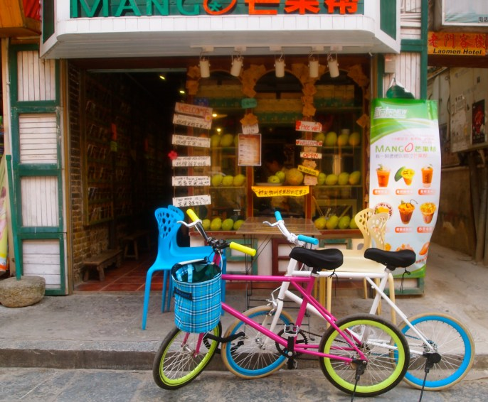 another fruit stand with colorful bicycles