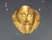 the Mask of Agamemnon, unearthed at Mycenae, along with bronze daggers and intricate representations of the hunt