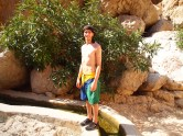 Alex stands on the edge of a falaj in Wadi Shab