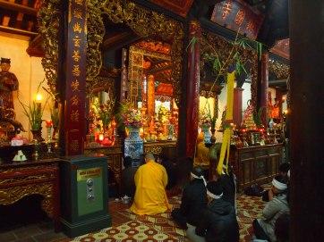 Buddhists worshiping in Hanoi, Vietnam
