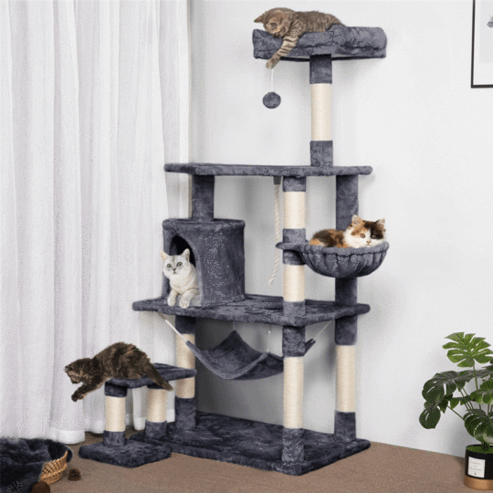 yaheetech cat tree with cats climbing and playing all over it