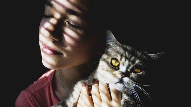 girl with her adorable cat