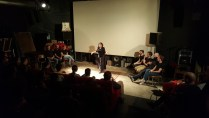 Adria enticing the audience into wolf-howling.