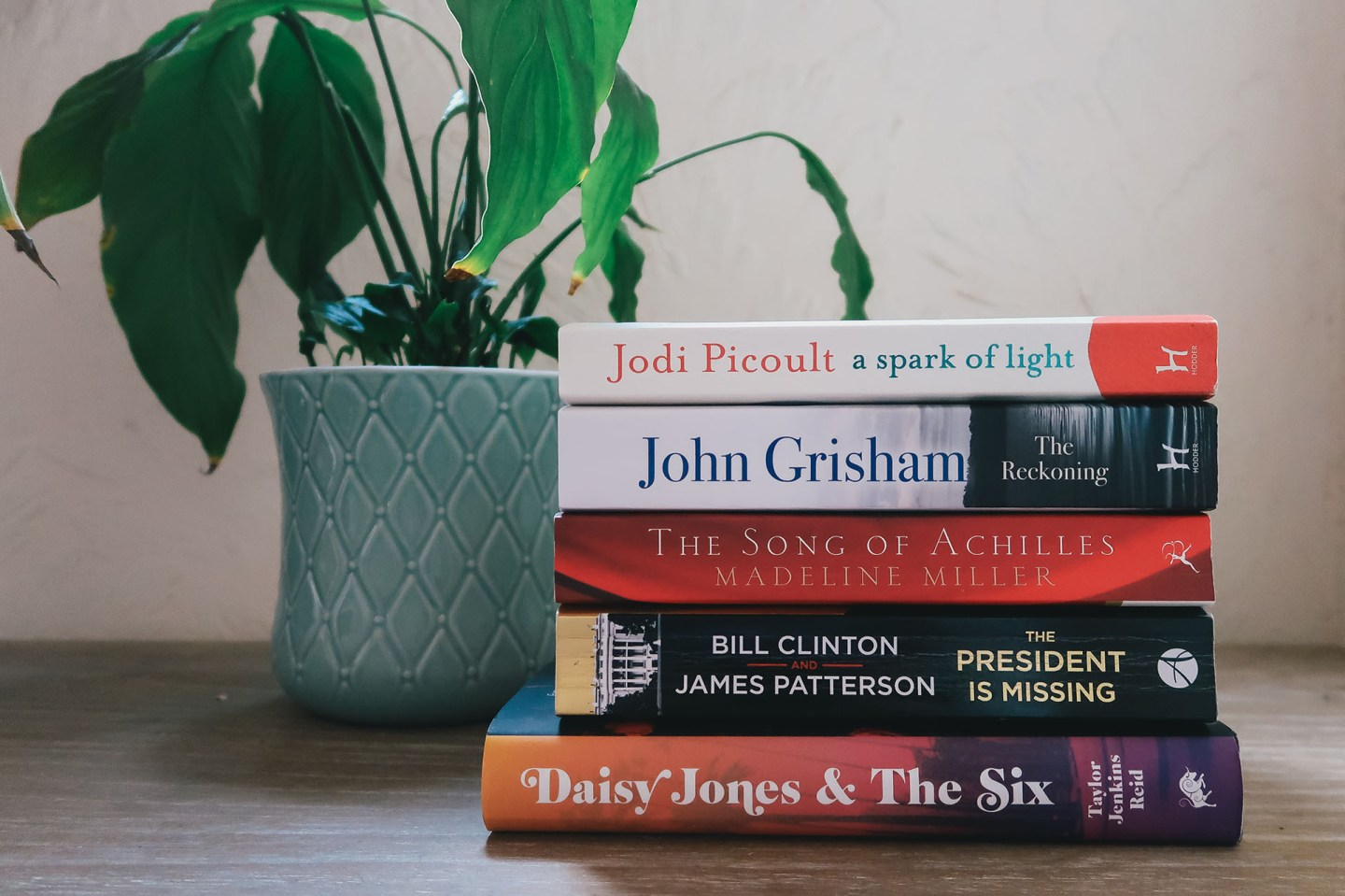 Book stack and plant