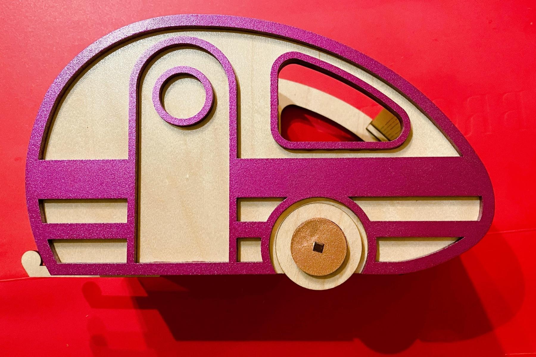 Retro camper in metallic pink