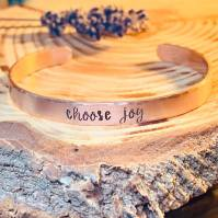 choose joy hand stamped on copper cuff lowercase cursive hammered edge textured (as shown). $24