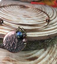 copper/antiqued brass bangle bracelet includes copper fern charm lapis bead clay bead. $20