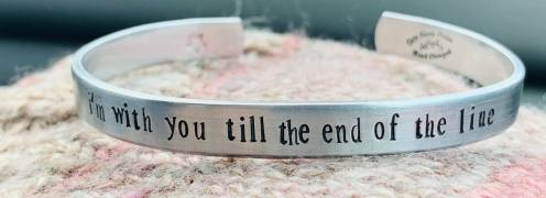 I'm with you till the end of the line with a small star stamped on the inside (quote from Captain America) hand stamped one letter at a time on silver pewter cuff smooth finish as shown. $24