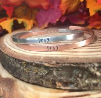 pray hand stamped on silver or copper cuff. $20