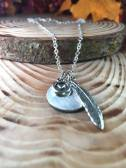 "blank silver disc includes heart charm feather 30"" silver chain. $30"