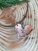 Teach Love Inspire hand stamped on hammered copper heart. $24