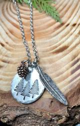 3 trees hand stamped on 7/8' silver pewter with feather and copper pinecone includes 30' silver chain. $30