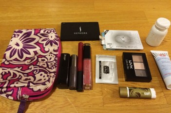 Lip colors and balm, mirror, oil blotting sheets, eye shadow, hand cream and emergency fashion tape