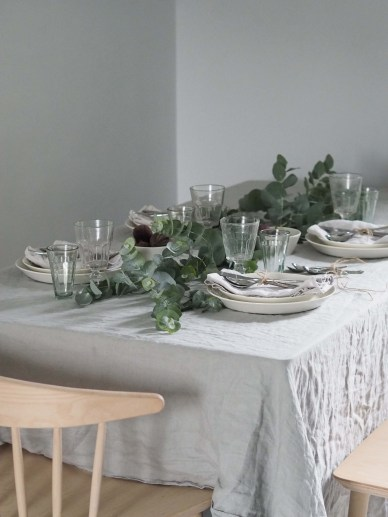 An informal dinner party table with greenery and soft linen - uplift the everyday with Robert Welch cutlery