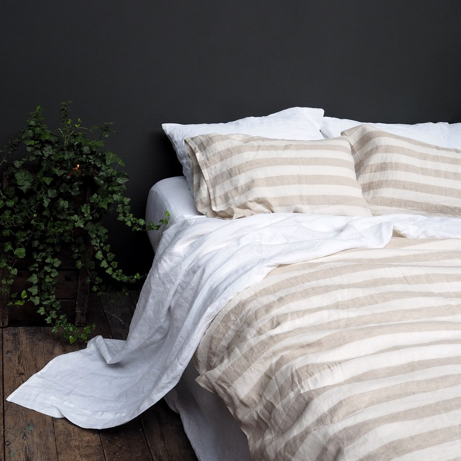 7 best places to buy pure linen bedding - Milk Honey striped linen duvet cover from £138, pillowcases £32 for two, Piglet