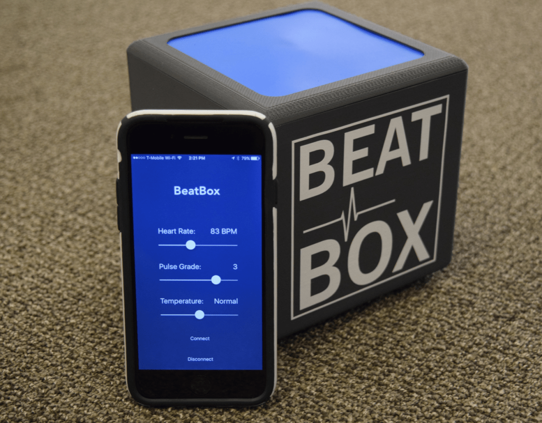 Our final prototype. Pulse rate, strength, and temperature are controlled by an iPhone app using Bluetooth LE, allowing instructors to be in a different room than trainees, even without an internet connection.