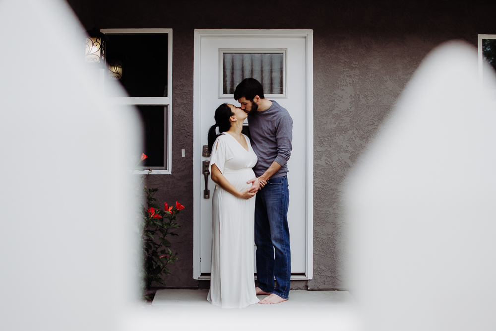 in home couple maternity husband and wife with baby belly {san diego newborn baby child family photographer}