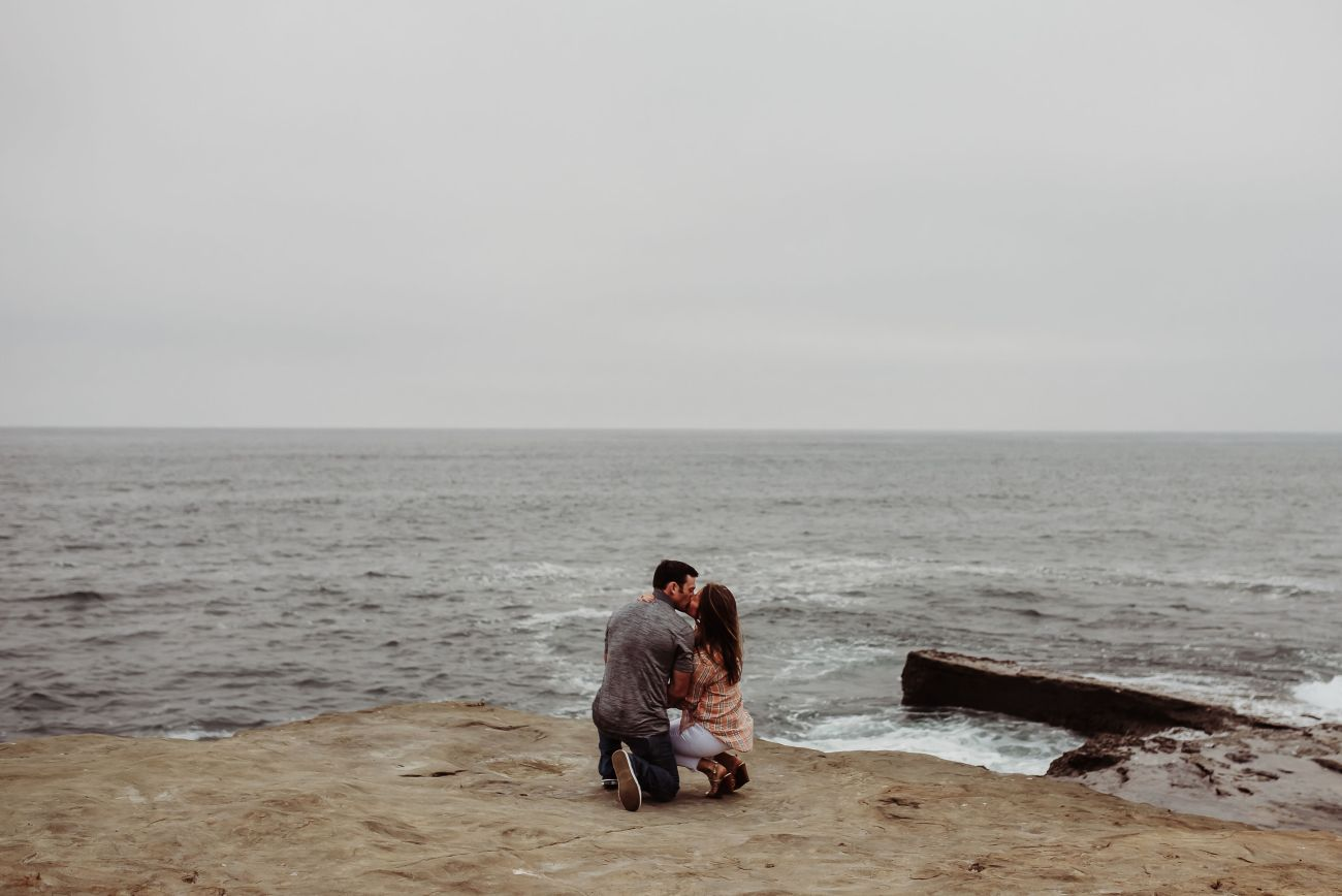 surprise engagement sunset cliffs couple in love kissing holding hands {san diego lifestyle child couples family military homecoming photographer holistic healer transformational mentor}