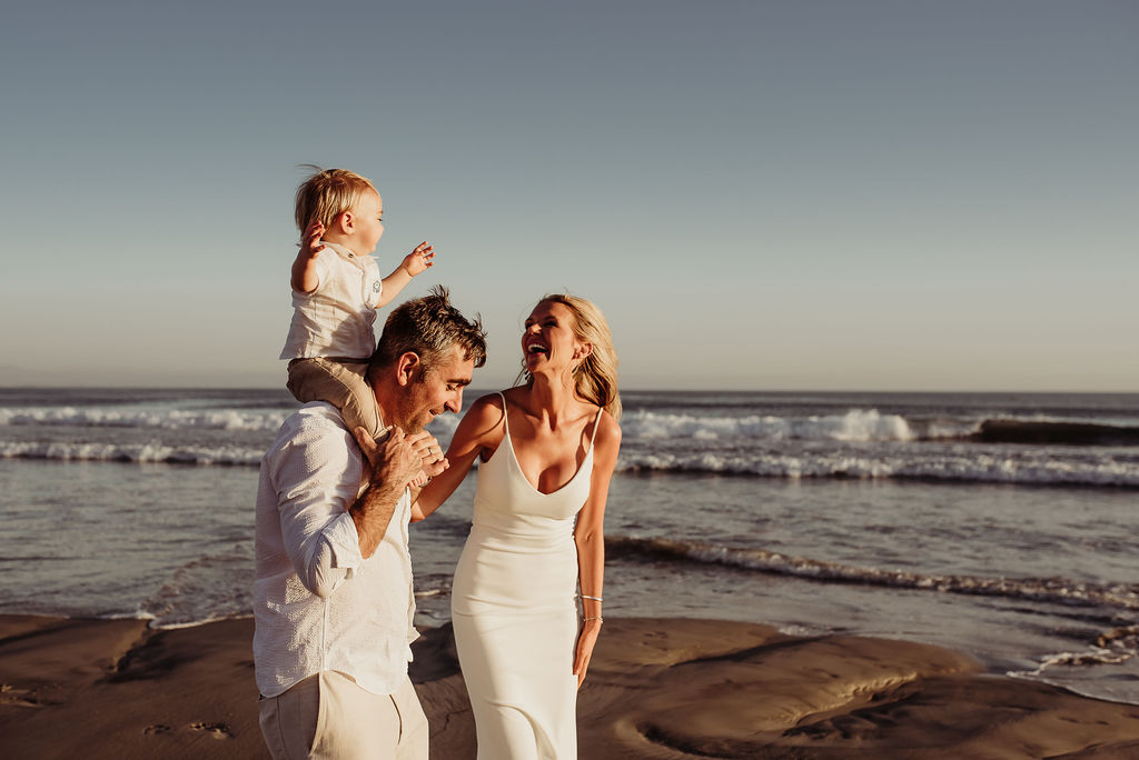 baby boy with mother and father laughing playing breakers beach coronado {san diego lifestyle child couples family military homecoming photographer holistic healer transformational mentor}