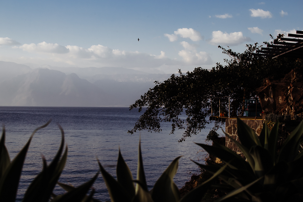 house overlooking lake atitlan guatemala spiritual retreat bird flying {virginia beach lifestyle newborn child couples family maternity engagement photographer}
