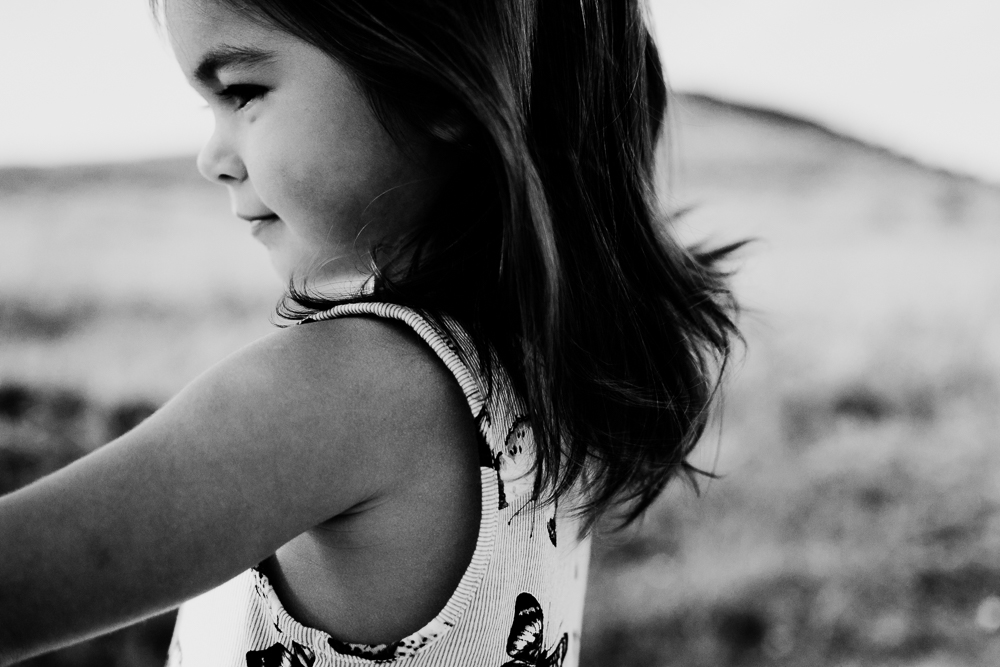 black and white little girl playing in field {virginia beach photographer}
