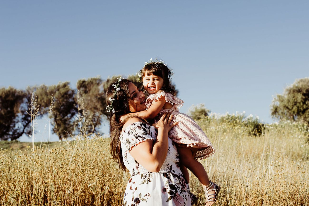 little boy and girl playing in flower fields with mother {san diego lifestyle newborn child couples family maternity engagement photographer}