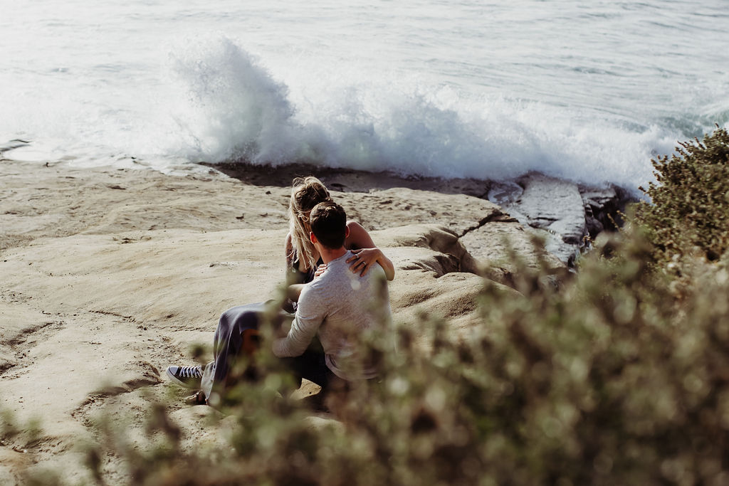 couple hugging kissing at sunset cliffs beach engagement photography {san diego lifestyle newborn child couples family maternity engagement photographer}
