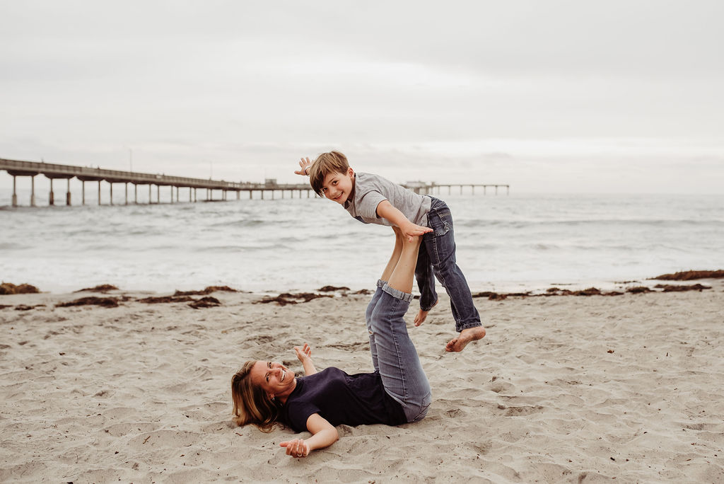 family photo session ocean beach sons mother father laughing playing hugging {san diego lifestyle child couples family military homecoming photographer holistic healer}