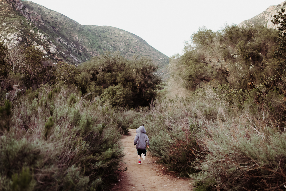 boy running through mission trails san diego hiking {virginia beach lifestyle child couples family military homecoming photographer holistic healer transformational mentor}