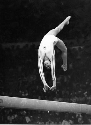 nadia comenichi flips on the balance beam