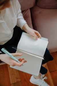 Hand with pen and notebook