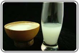 Palm wine in the traditional bowl and a modern glass