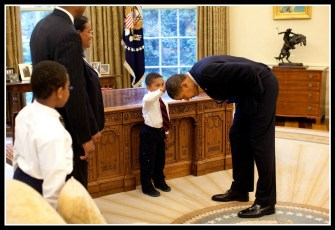 President Obama in the famous photo in the Oval Office