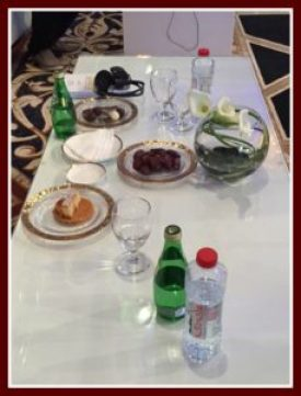 Tables with food set for His Highness and others