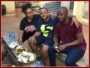 Sam, center, with cousins Nonso left, and Osita, eating roasted yam for breakfast.