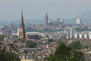 View of the city of Glasgow with church towers, buildings and a bridge