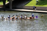 The Blazing Paddles dragon boat team starts to make the turn in the International Dragon Boat Festival on June 14, 2014, on Brush Creek in the Country Club Plaza in Kansas City, Missouri.