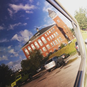 Rounds Hall reflected in car window