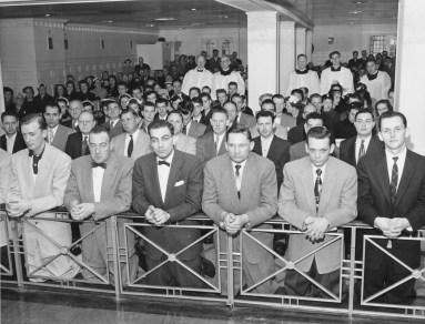 CATHOLICS SHOWN KNEELING AT COMMUNION RAIL IN 1955 PHOTO