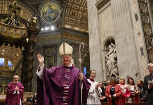 Newly ordained Bishop Paul Tighe, a priest of the Archdiocese of Dublin, greets the faithful during his ordination to the episcopate in St. Peter's Basilica at the Vatican Feb. 27, 2016. (Photo courtesy Paul Haring, Catholic News Service)