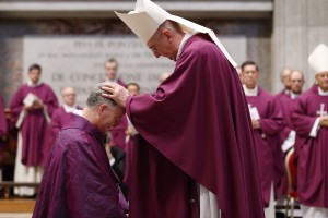 Archbishop Diarmuid Martin of Dublin blesses newly ordained Bishop Paul Tighe, a priest of the Archdiocese of Dublin, during his ordination to the episcopate in St. Peter's Basilica at the Vatican Feb. 27, 2016. (Photo courtesy Paul Haring, Catholic News Service)