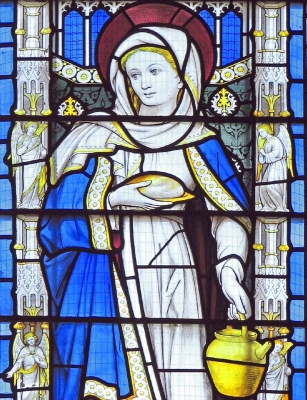 detail of a stained glass window of Saint Martha; designed by Comper, c.1905-7; east window, All Saints' Convent chapel, Oxford, England; swiped with permission from the flickr account of Father Lawrence Lew, OP