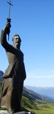 detail of a photo of a statue of Saint Bernard that stands at Little Saint Bernard Pass, an area of the Alps between France and Italy; taken on 19 July 2006 by Vberger; swiped from Wikimedia Commons
