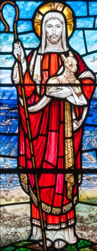 detail of a stained glass window depicting Jesus as the Good Shepherd; the background imagery is the World War II invasion of Normandy; by William Morris and Company of Westminster, London, 1953; centre light, south aisle, Saint Patrick's Church, Coleraine, County Londonderry, Ireland; photographed on 13 September 2014 by Andreas F. Borchert; swiped from Wikimedia Commons
