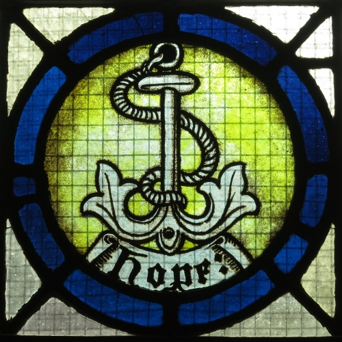 detail of a stained glass window depicting an anchor, an emblem of hope; date and artist unknown; Saint Vincent de Paul Catholic Church, Mount Vernon, Ohio; photographed on 2 April 2016 by Nheyob; swiped from Wikimedia Commons