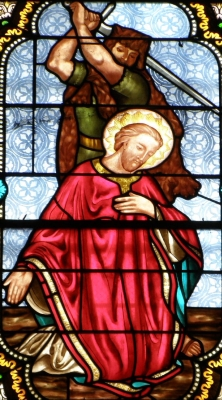 detail of a stained glass window depicting the martyrdom of Saint Caprasius of Agen, 1866, artist unknown; Saint-Caprais church, Craponne-sur-Arzon, Haute-Loire, France; photographed in August 2009 by Torsade de Pointes; swiped from Wikimedia Commons
