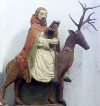 statue of Saint Edern on his stag, date unknown, artist unknown; Church of Saint Edern, Brittany, France; photographed on 21 September 2014 by Moreau.henri; swiped from Wikimedia Commons