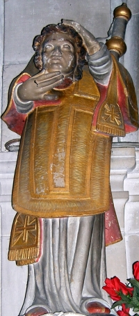 statue of Saint Elophe carrying his severed head; 1709, artist unknown; inside the church at Domrémy-la-Pucelle, Vosges, France; photographed on 25 October 2006 by PRA; swiped from Wikimedia Commons